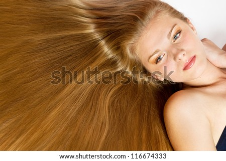 Portrait of Beautiful Woman with smooth gloss long hair.