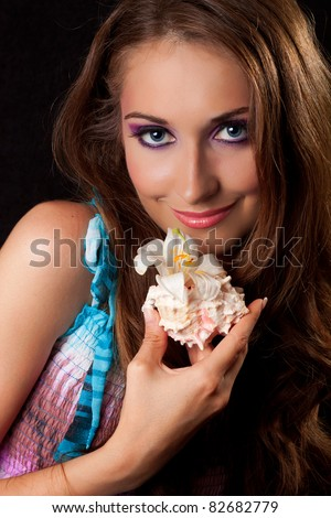 Portrait of beautiful woman with starfish and shell