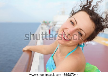 portrait of beautiful woman. woman standing on deck of cruise ship. - stock photo