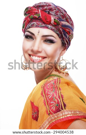 Portrait of beautiful woman wrapped in scarf in saree close up