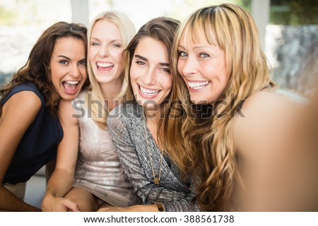 Portrait of beautiful women having fun at party - stock photo