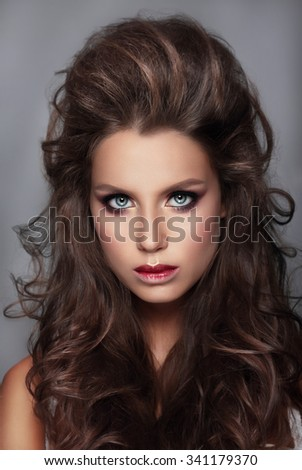 Portrait of  beautiful women with bright makeup and curly hairs. - stock photo