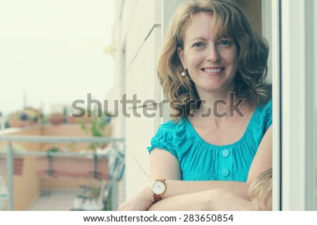 Portrait of beautiful 35 years old woman. Instagram filter. - stock photo