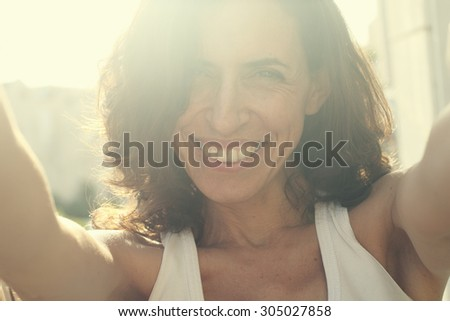 Portrait of beautiful 35 years old woman on sunset colors - stock photo