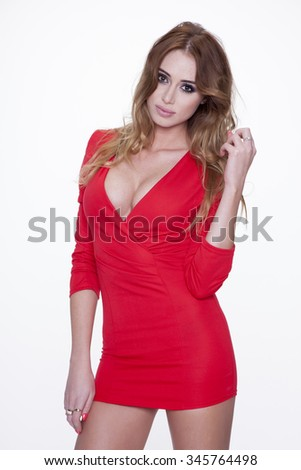 Portrait of beautiful young adult attractive sexy and sensuality happy smiling pretty blonde woman in red erotic elegance fashionable dress isolated on white background