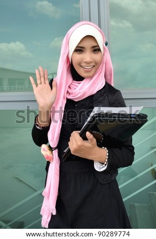Portrait of beautiful young Asian Muslim business woman smile