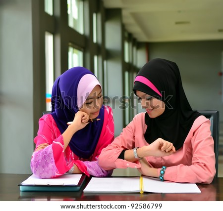 portrait of beautiful young Asian Muslim woman study together