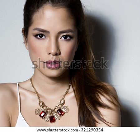 portrait of beautiful young asian woman with flawless skin and perfect make-up - stock photo