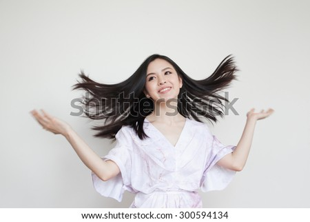 Portrait of beautiful young Asian woman with healthy hair - stock photo
