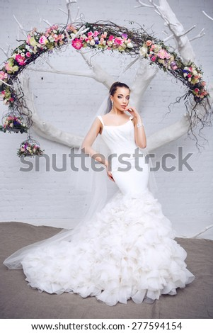 Portrait of Beautiful Young Attractive Bride with Flowers. Wedding Dress. Wedding decorations Young attractive bride with - stock photo