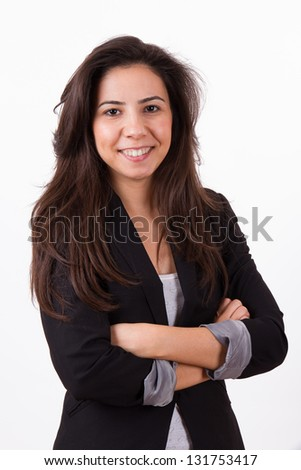 Portrait of beautiful, young, attractive, confident business woman, smiling and standing in black suit, isolated on white background.