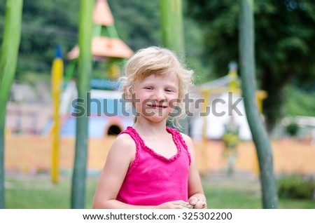 portrait of beautiful young blond girl laughing - stock photo