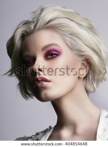 Portrait of beautiful young blond woman with clean face. Fresh makeup. Attractive sensual girl