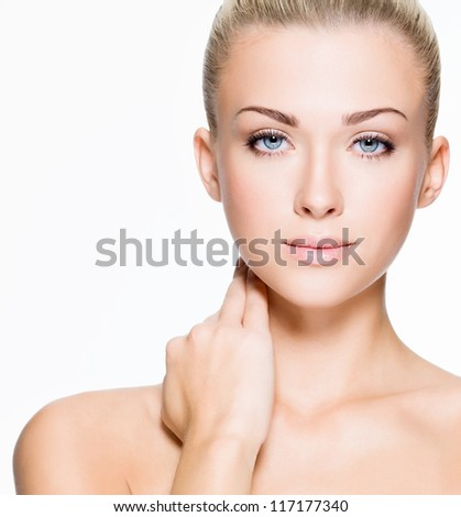 Portrait of beautiful young blond woman with clean face - isolated on white - stock photo