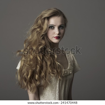 Portrait of beautiful young blonde girl in white dress. Fashion photo - stock photo