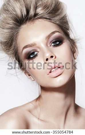 portrait of beautiful young blonde girls, with glowing skin, beautiful makeup and very puffy kissable lips, with professional retouching - stock photo
