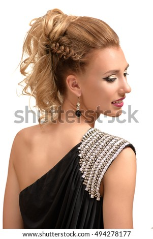 Portrait of beautiful young blonde woman with fashion hairstyle