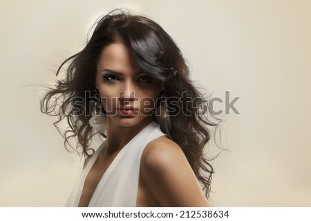 Portrait of beautiful young brunette girl in white dress. Fashion photo  - stock photo