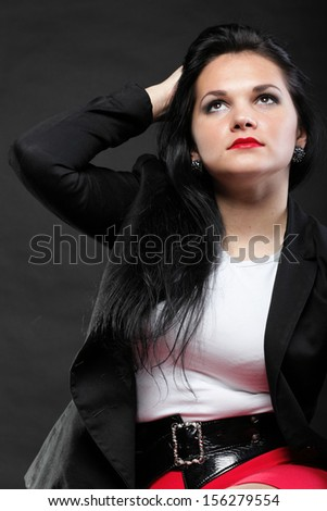 portrait of beautiful young brunette on black background. - stock photo