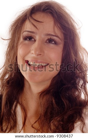 Portrait of beautiful young brunette smiling woman