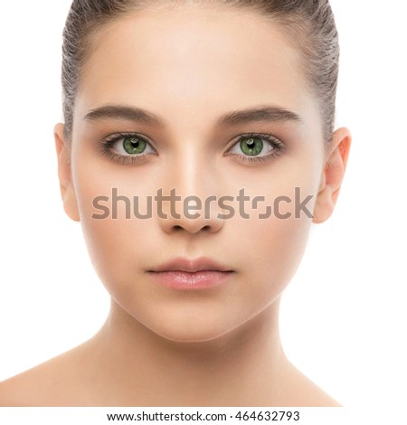 Portrait of beautiful young brunette woman with clean face. Beauty spa model girl with perfect fresh clean skin. Looking at camera and smiling. Youth and skin care concept. Isolated on a white