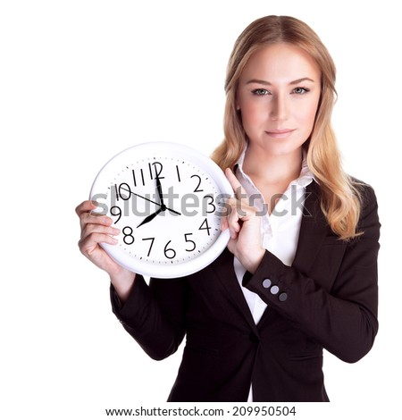 Portrait of beautiful young business woman holding in hands clock, isolated on white background, discipline and punctual concept  - stock photo