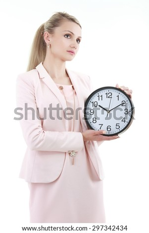 Portrait of beautiful young business woman holding in hands clock, isolated on white background