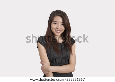Portrait of beautiful young businesswoman smiling over white background
