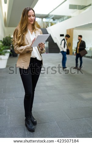 Portrait of beautiful young businesswoman using her mobile phone. - stock photo