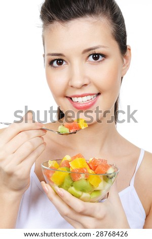 portrait of beautiful young cheerful woman with fruit dessert