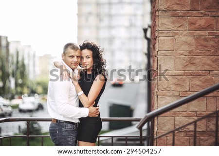 Portrait of beautiful young couple downtown together.