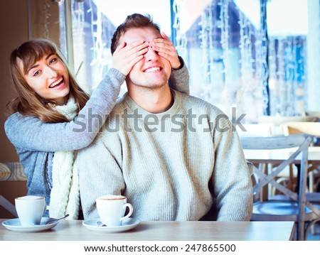 Portrait of beautiful young couple in love, couple having fun talking in cafe and drink coffee.  - stock photo