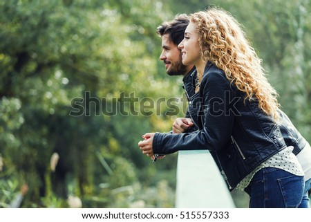 Portrait of beautiful young couple in the park.