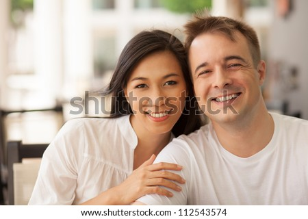 Portrait of beautiful young couple looking at camera - stock photo