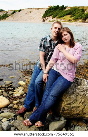 Portrait of beautiful young couple on beach in summer