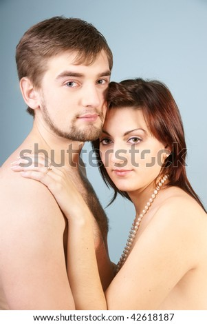 Portrait of beautiful young couple on blue background