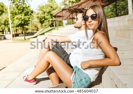 Portrait of beautiful young couple relaxing in the park.