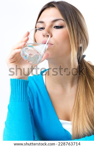 Portrait of beautiful young drinking water. Isolated on white. - stock photo