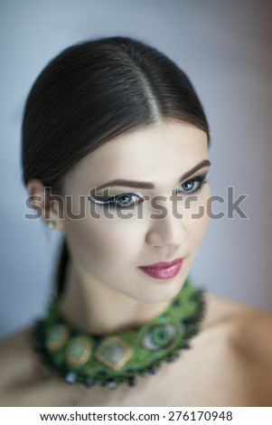 Portrait of beautiful young elegant woman,girl, lady,actress, goddess, model, wealth luxury. Perfect bright color makeup, beautiful face,soft skin, natural lip, beige, gloss, straight hair, jewellery - stock photo