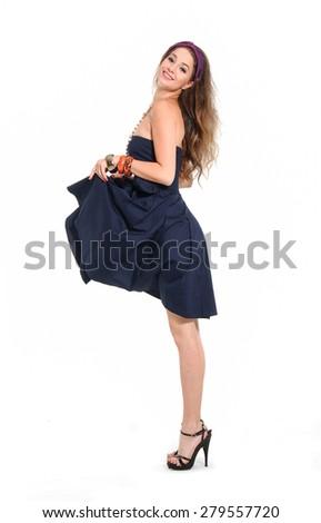 Portrait of beautiful young fashion woman in black sundress posing  - stock photo