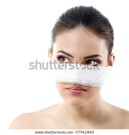 portrait of beautiful young female face with bandage on her nose - beauty treatment plastic surgery - stock photo