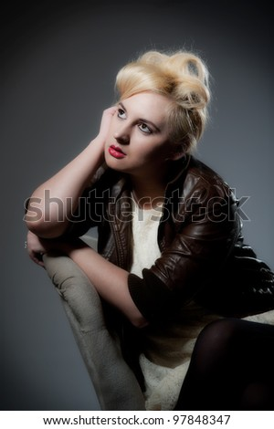 Portrait of beautiful young female in leather jacket