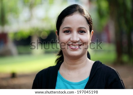 Portrait of beautiful young female student at college campus