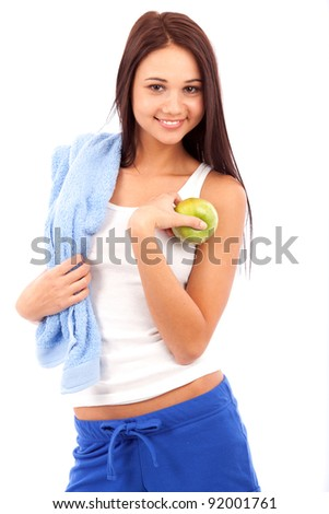 portrait of beautiful young girl holding green apple isolated on white