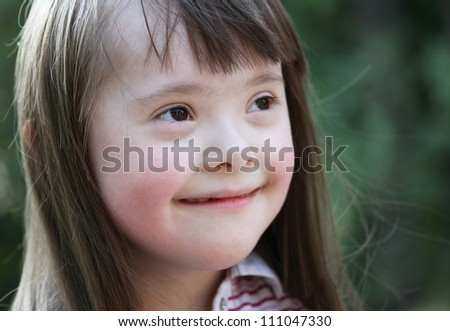 Portrait of beautiful young girl in the park. - stock photo