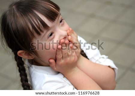 Portrait of beautiful young girl in the park - stock photo
