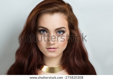 Portrait of beautiful young girl, lady, model, woman. Perfect daytime makeup, expressive eyes, natural color, lips,gorgeous long hair. Image can be used for advertising shampoo, conditioner,hair balm. - stock photo
