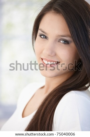 Portrait of beautiful young girl smiling happily.? - stock photo
