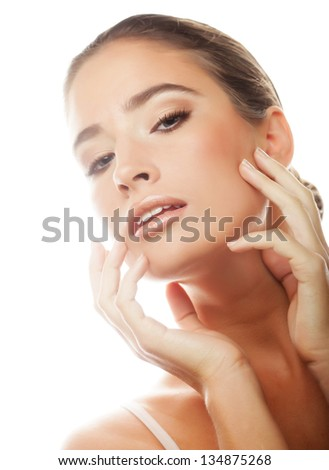 Portrait of beautiful young girl with clean skin on pretty face
