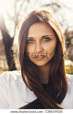 Portrait of beautiful young girl with long hair - stock photo